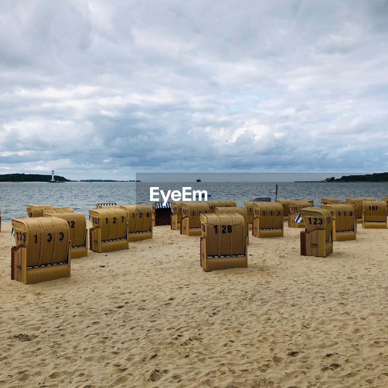 beach, sand, land, sea, cloud - sky, sky, hooded beach chair, water, scenics - nature, horizon over water, beauty in nature, horizon, tranquility, nature, tranquil scene, day, absence, no people, outdoors