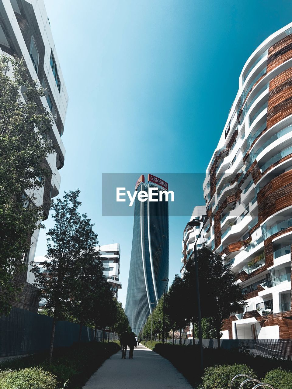 building exterior, architecture, city, sky, built structure, tree, plant, nature, building, day, the way forward, transportation, road, clear sky, direction, street, office building exterior, outdoors, office, incidental people, modern, skyscraper