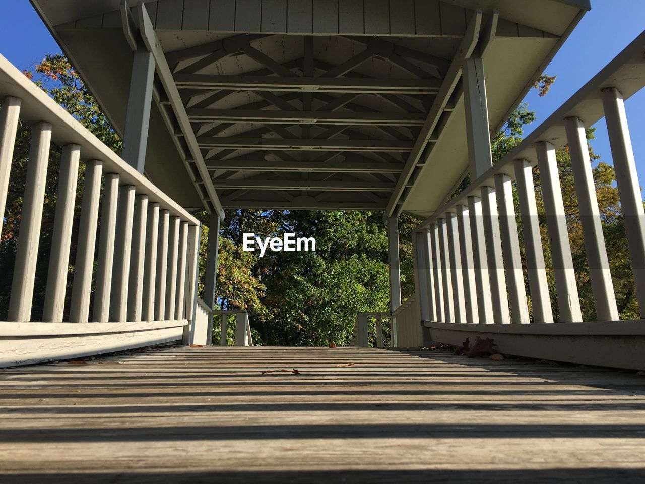 architecture, built structure, day, no people, nature, bridge, pattern, sunlight, direction, the way forward, tree, railing, outdoors, bridge - man made structure, connection, plant, wood - material, shadow, metal, staircase, architectural column, ceiling