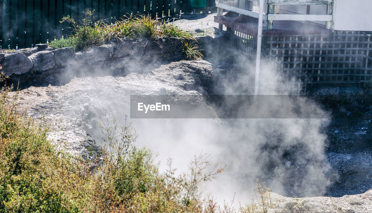 smoke - physical structure, nature, heat - temperature, water, day, steam, no people, plant, power in nature, outdoors, beauty in nature, power, land, motion, sunlight, scenics - nature, tree, rock, hot spring