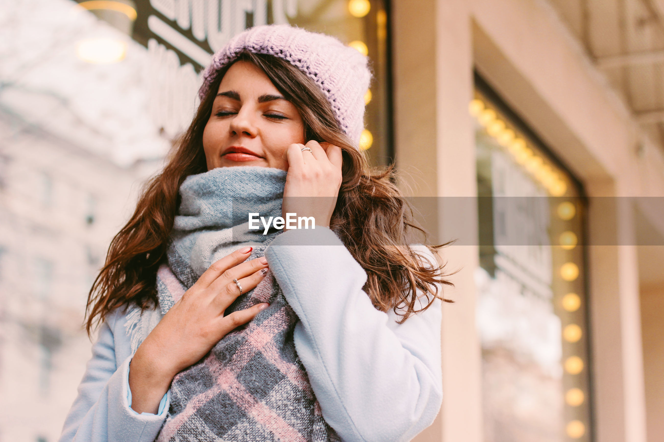 Woman in city during winter