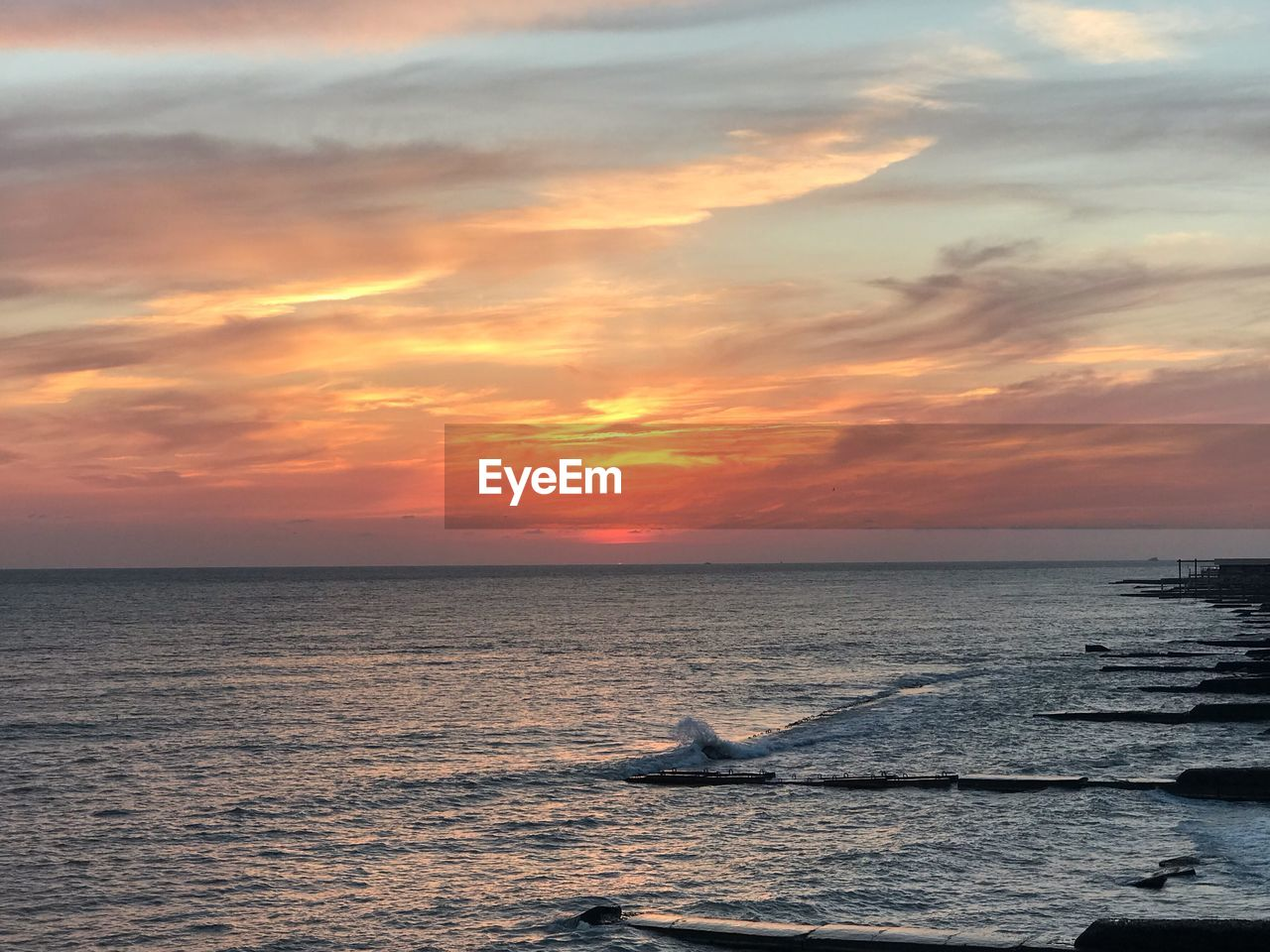 water, sea, sky, sunset, horizon, beauty in nature, horizon over water, cloud - sky, scenics - nature, orange color, tranquility, waterfront, nature, tranquil scene, idyllic, outdoors, motion, non-urban scene, no people, marine
