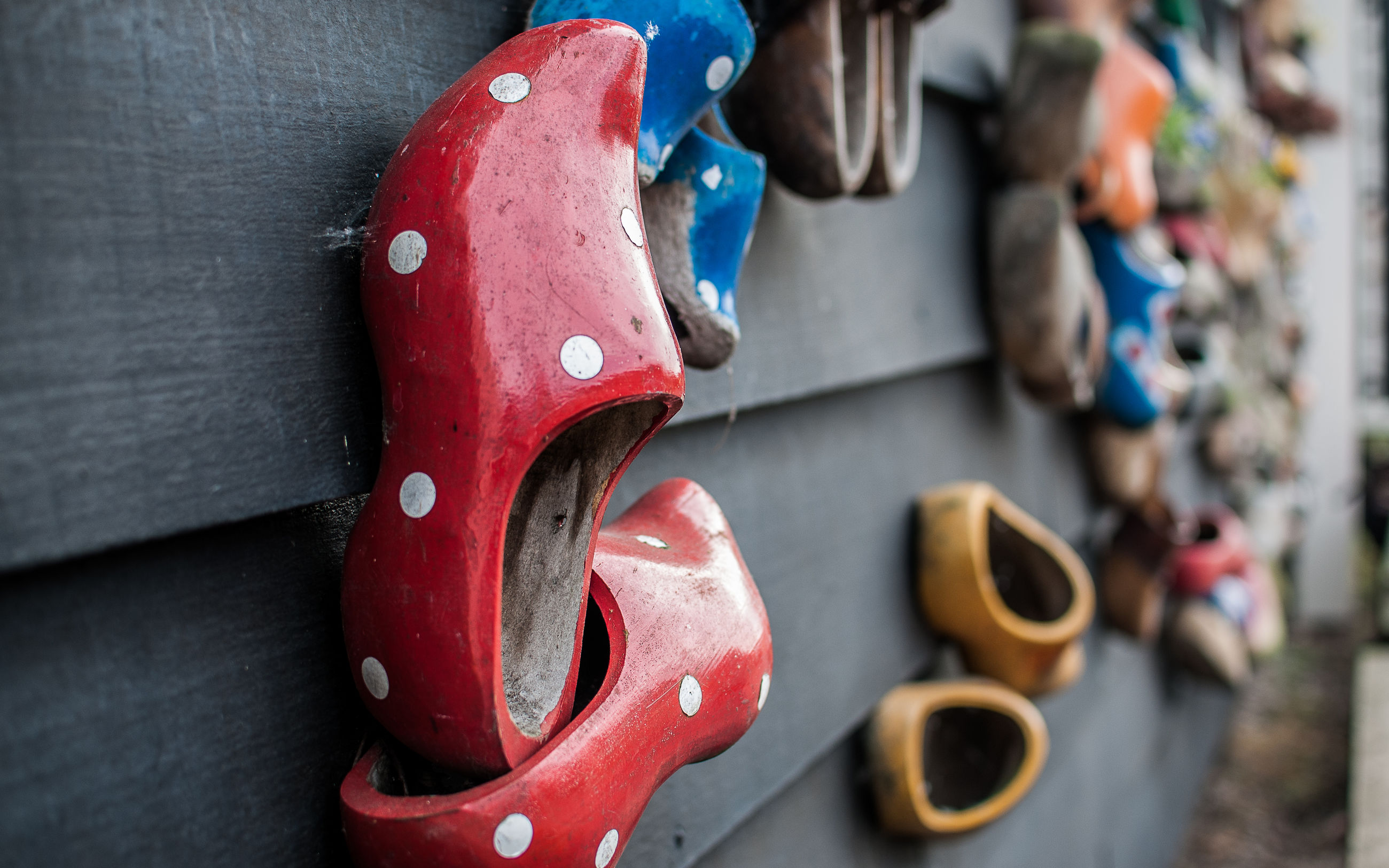 red, close-up, focus on foreground, indoors, still life, multi colored, selective focus, toy, art and craft, no people, day, creativity, hanging, animal representation, variation, high angle view, metal, in a row, art