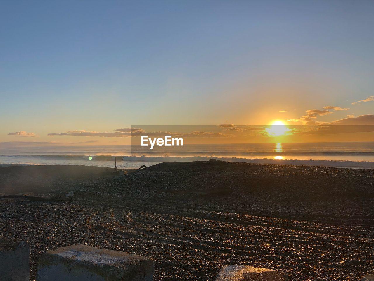 sky, sunset, sea, scenics - nature, water, beauty in nature, beach, land, nature, tranquility, tranquil scene, sun, sunlight, idyllic, horizon, horizon over water, cloud - sky, non-urban scene, orange color, no people, outdoors