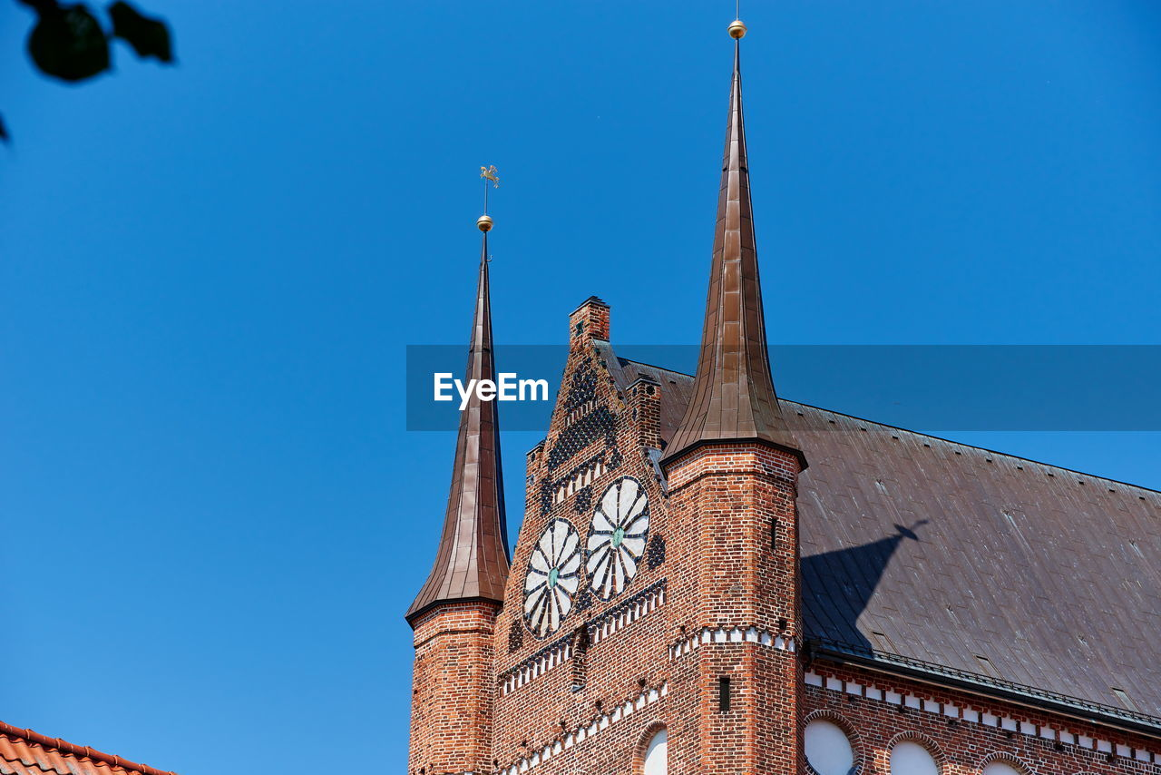 built structure, architecture, sky, low angle view, blue, building exterior, building, clear sky, tower, religion, nature, no people, belief, place of worship, travel destinations, day, spirituality, spire, outdoors, ornate