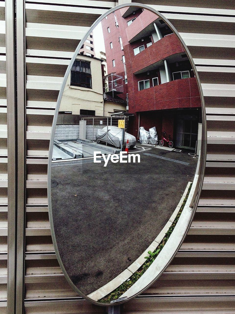 Close-up of convex mirror at wall