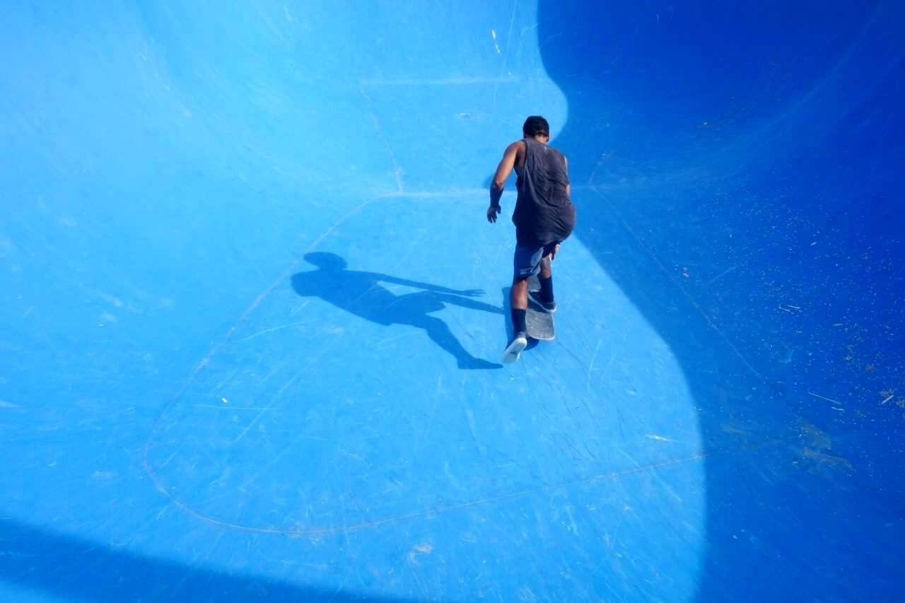 blue, full length, one person, one man only, people, ice rink, only men, adult, adults only, swimming pool, ice-skating, day, skateboard park, outdoors, young adult