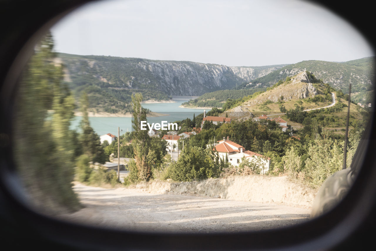 Scenic View Of River And Mountains Seen Through Window