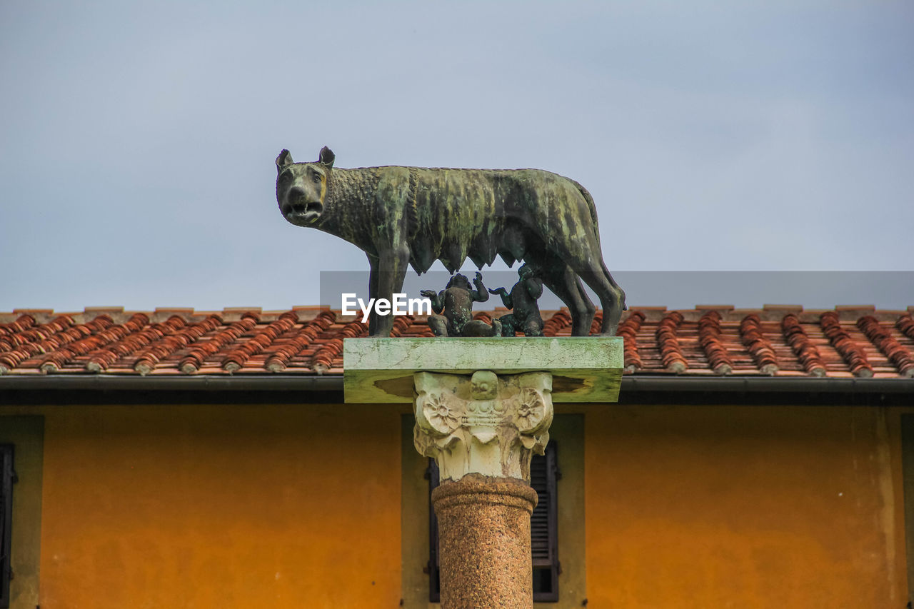 representation, architecture, art and craft, sky, no people, animal, day, sculpture, built structure, building exterior, animal representation, nature, mammal, low angle view, creativity, clear sky, animal themes, statue, roof, craft, roof tile