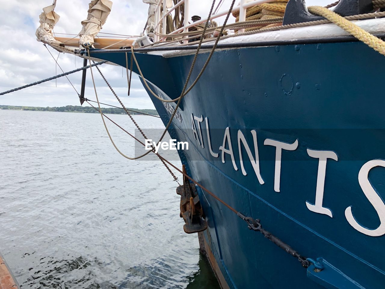 nautical vessel, water, mode of transportation, transportation, sea, moored, rope, day, ship, no people, text, nature, sailing, number, outdoors, sailboat, communication, western script, travel, nautical equipment