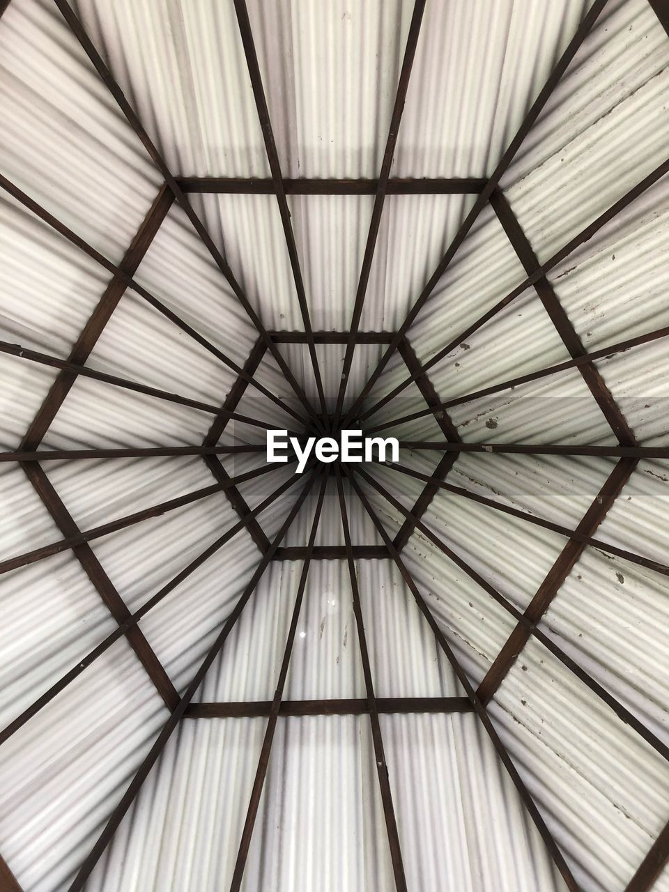pattern, full frame, backgrounds, ceiling, indoors, no people, low angle view, design, protection, close-up, security, shape, directly below, geometric shape, architecture, white color, umbrella, day, repetition, safety, sheltering