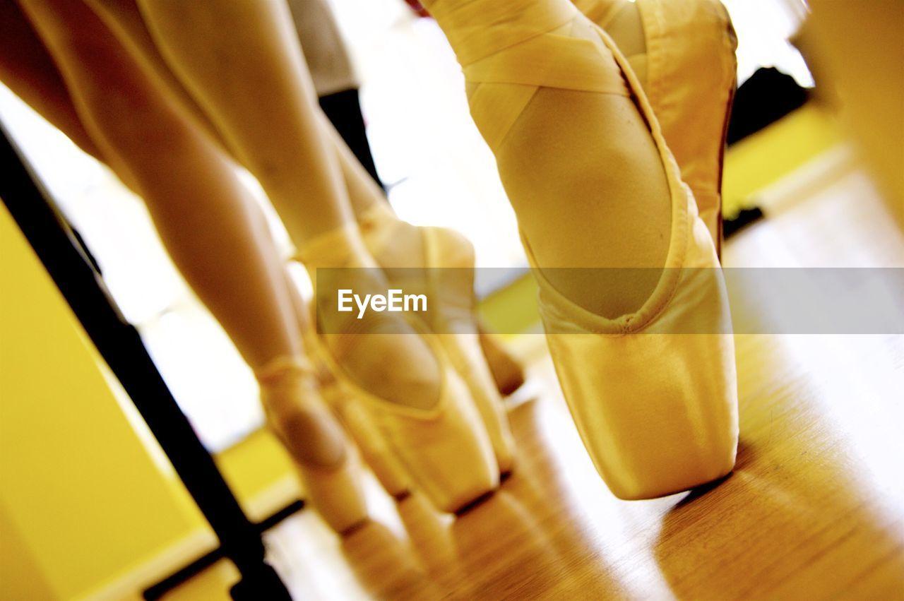 Low Section Of Ballet Dancer Dancing In Studio