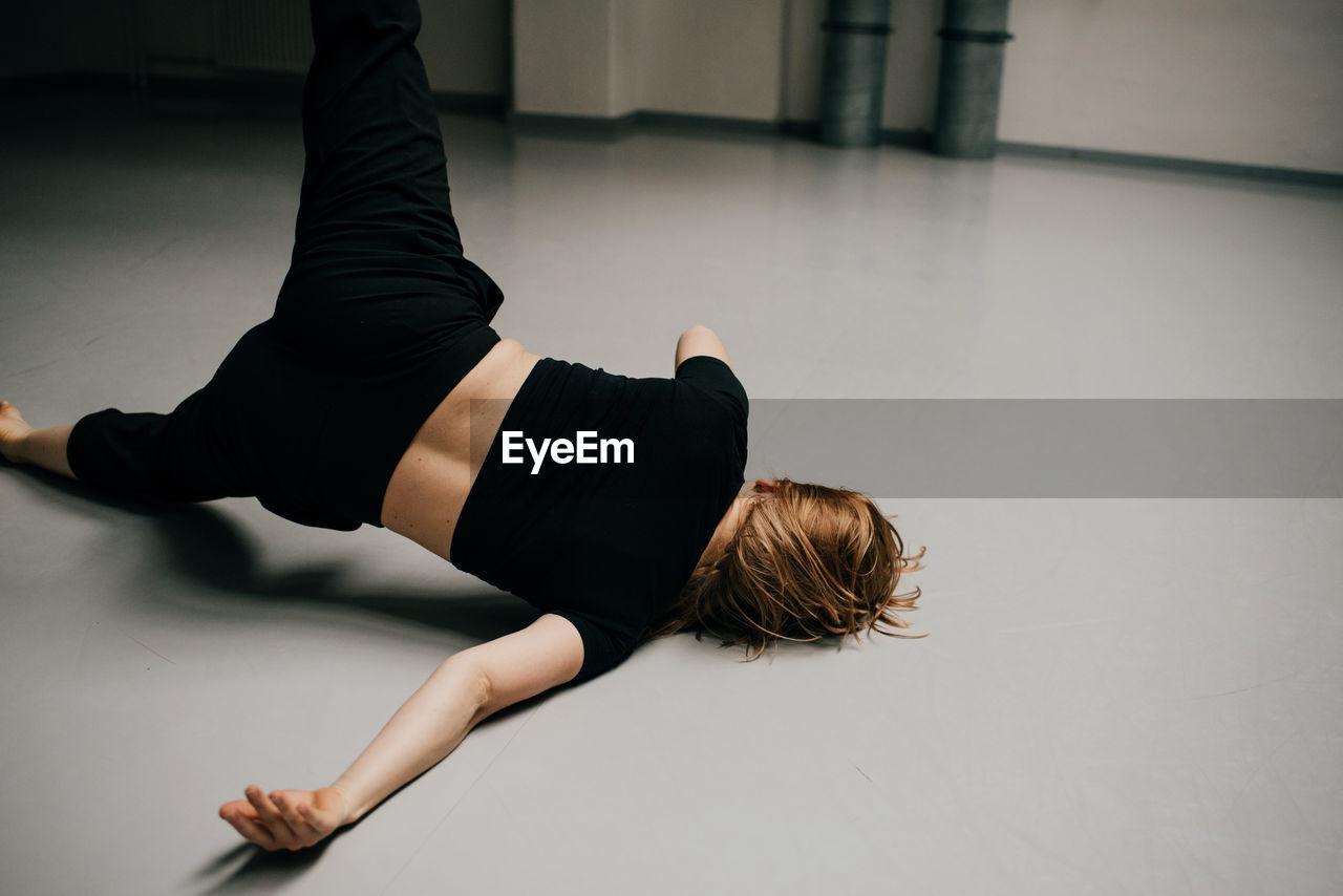 High Angle View Of Woman Dancing On Floor