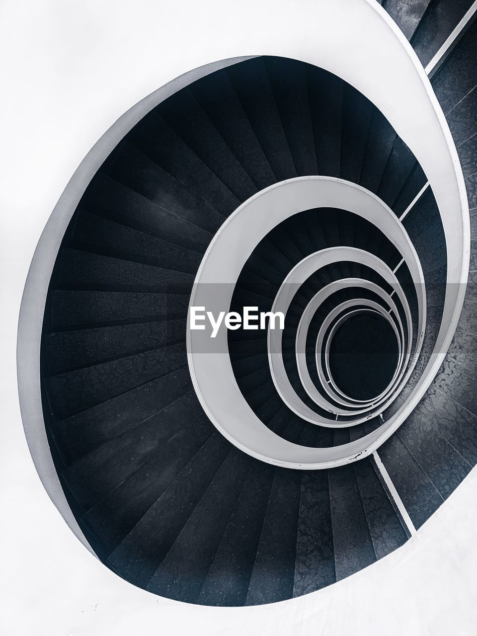 spiral, steps and staircases, staircase, spiral staircase, architecture, built structure, railing, design, geometric shape, pattern, indoors, circle, shape, no people, high angle view, directly above, diminishing perspective, day, repetition, swirl, directly below, concentric