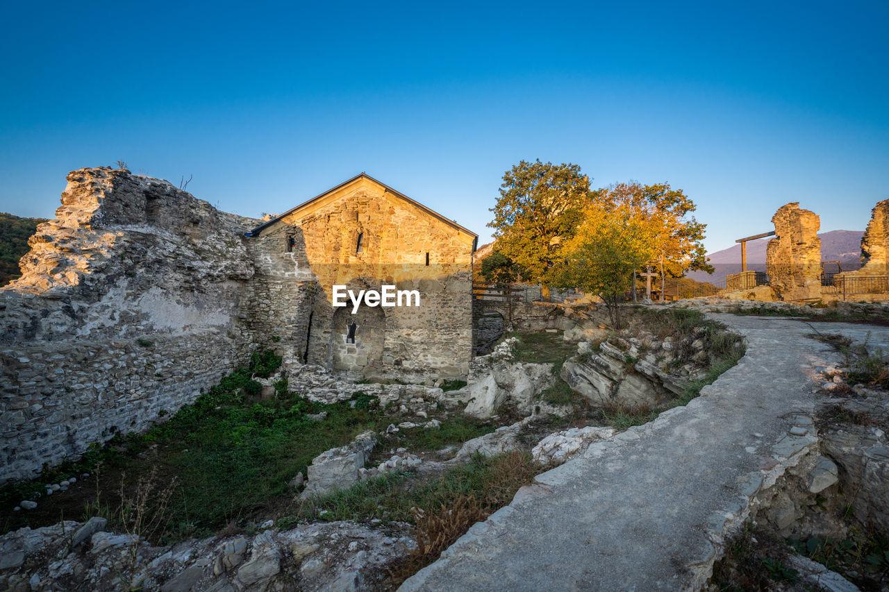 OLD BUILDINGS AGAINST BLUE SKY