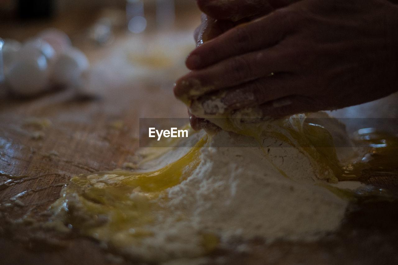Close-up of person preparing dough