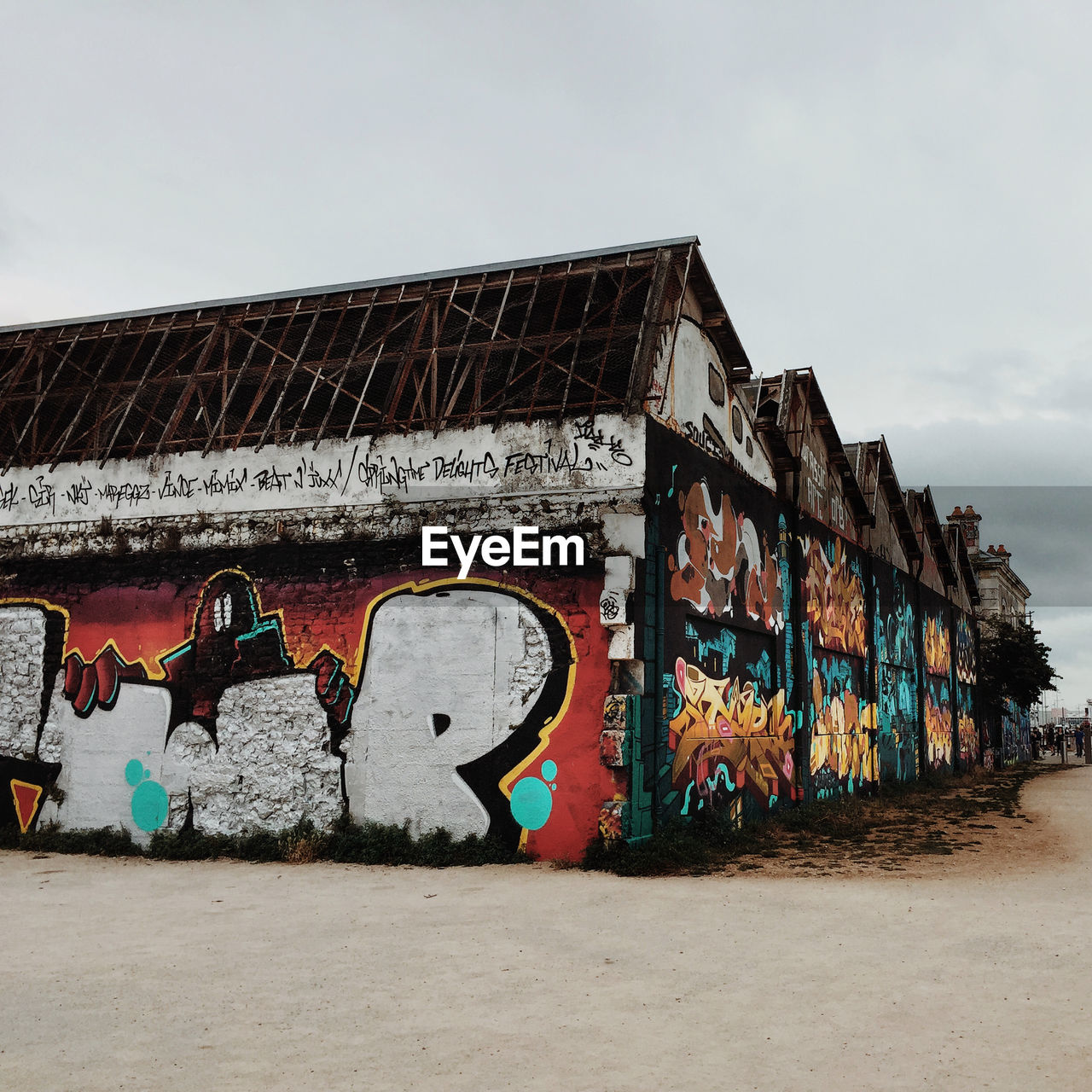 GRAFFITI ON WALL AGAINST BUILDING