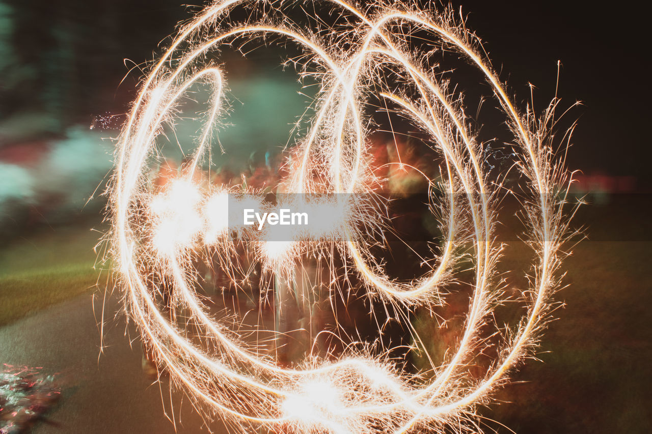 illuminated, night, motion, long exposure, glowing, blurred motion, celebration, arts culture and entertainment, heart shape, burning, creativity, firework, event, sparks, light painting, nature, no people, light, shape, outdoors, firework - man made object, wire wool, sparkler, firework display