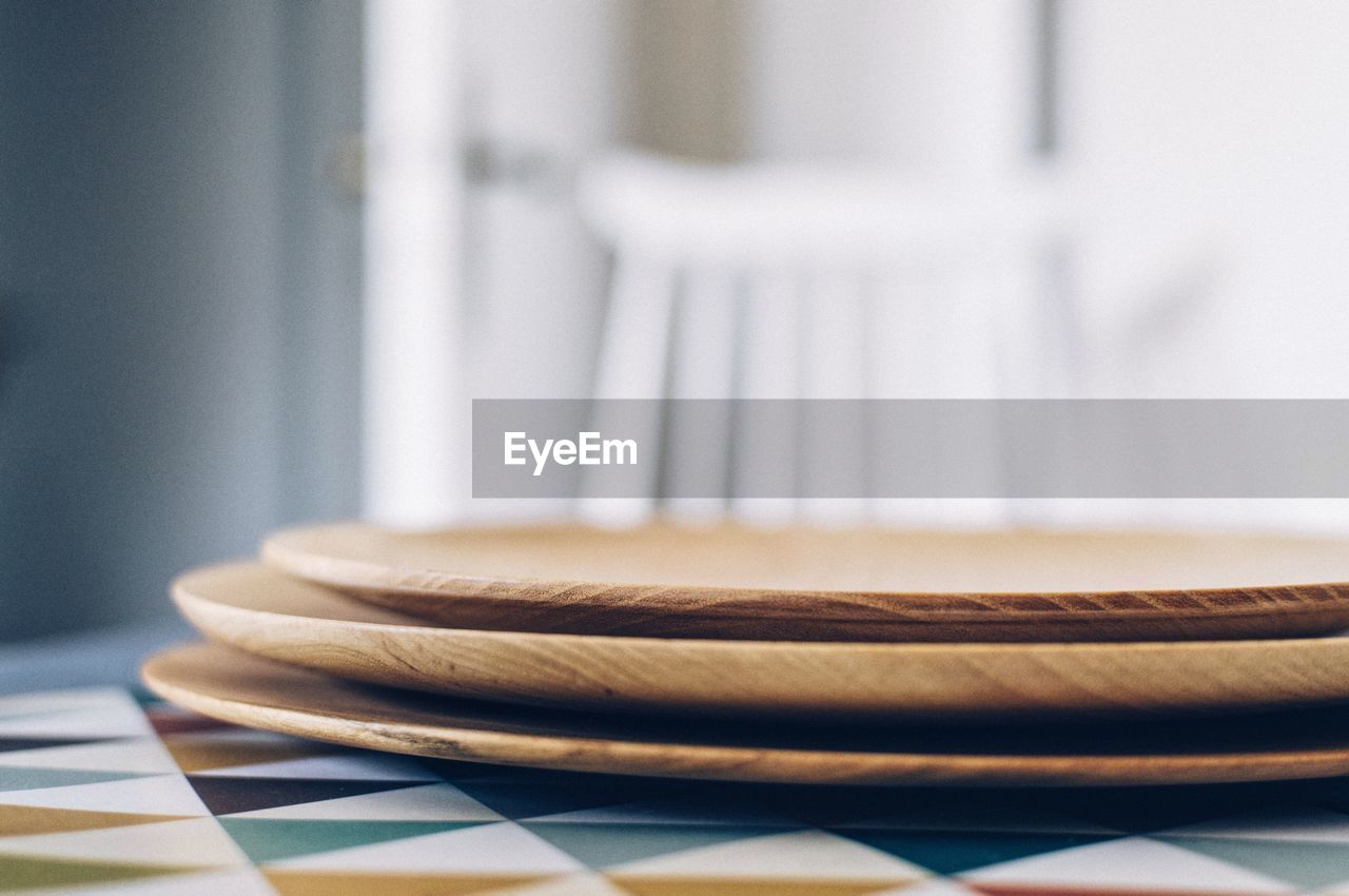 Extreme Close Up Of Plates On Table