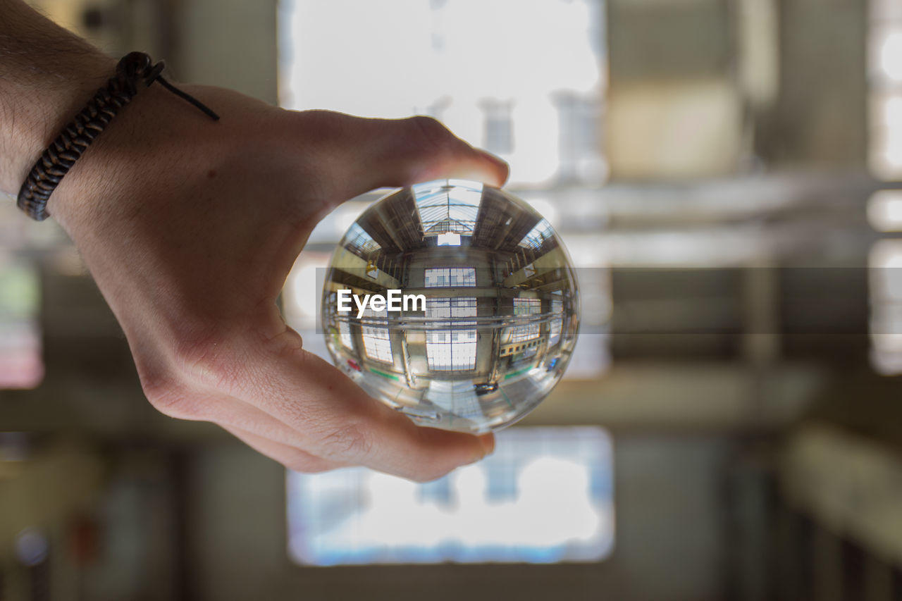 Cropped Image Of Hand Holding Crystal Ball