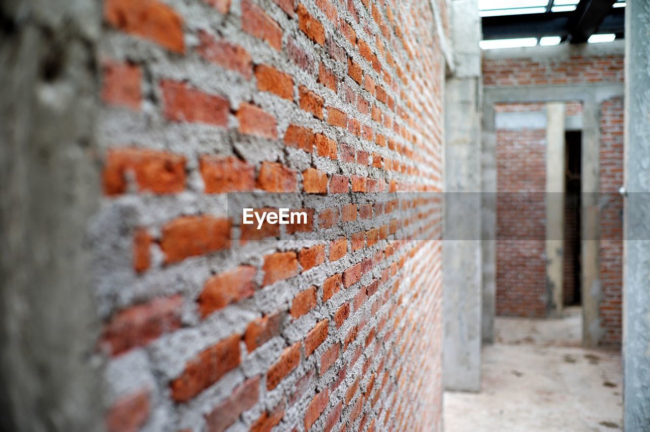 brick, brick wall, wall, built structure, architecture, wall - building feature, building exterior, day, no people, focus on foreground, building, close-up, outdoors, selective focus, textured, pattern, entrance, door, old, weathered