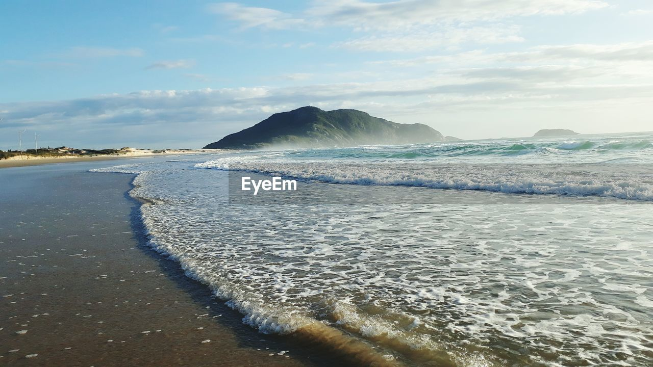 sea, water, beauty in nature, nature, scenics, sky, beach, tranquility, no people, outdoors, tranquil scene, day, cloud - sky, sand, wave, horizon over water