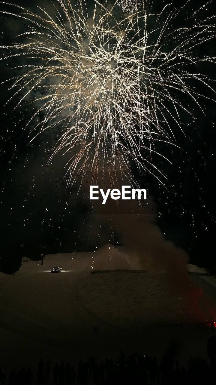night, firework display, exploding, firework - man made object, celebration, event, arts culture and entertainment, long exposure, low angle view, firework, outdoors, motion, no people, sky, awe, illuminated, water