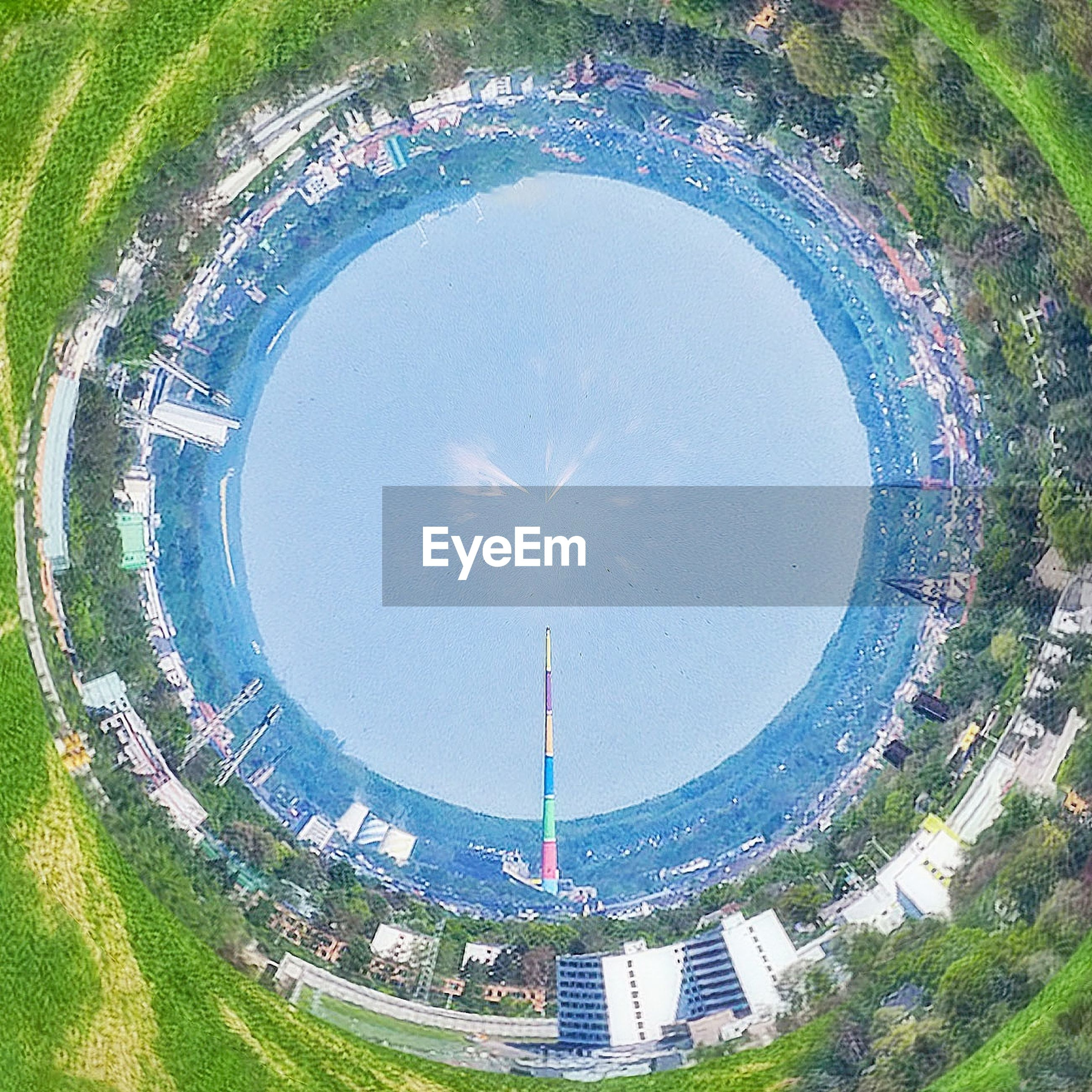 circle, day, high angle view, architecture, water, aerial view, outdoors, built structure, travel destinations, modern, no people, semi-circle, building exterior, fish-eye lens, tree