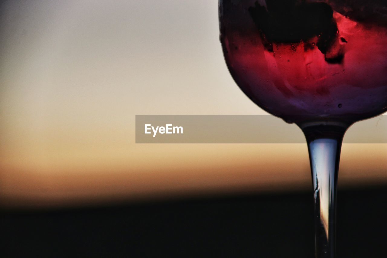 close-up, refreshment, sunset, drink, focus on foreground, no people, alcohol, wineglass, outdoors, freshness, beauty in nature, dripping, sky, nature, day
