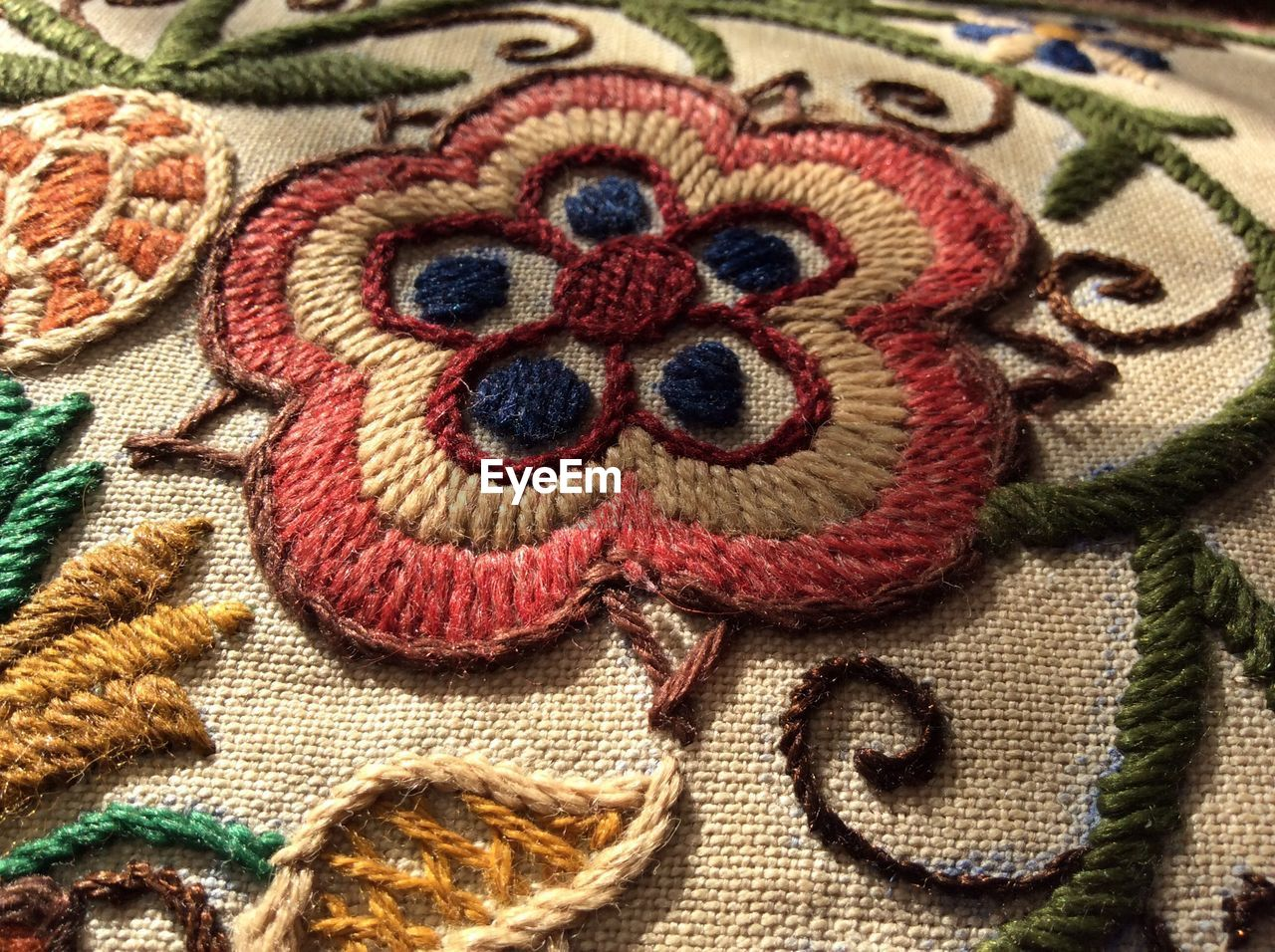 textile, art and craft, close-up, creativity, pattern, no people, multi colored, wool, craft, full frame, indoors, animal representation, animal, backgrounds, animal themes, still life, clothing, representation, mammal, knitted, floral pattern, embroidery, warm clothing