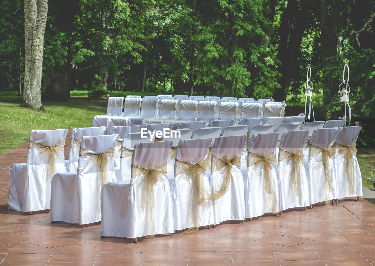 Arrangement Of Empty Wedding Chairs Outdoors