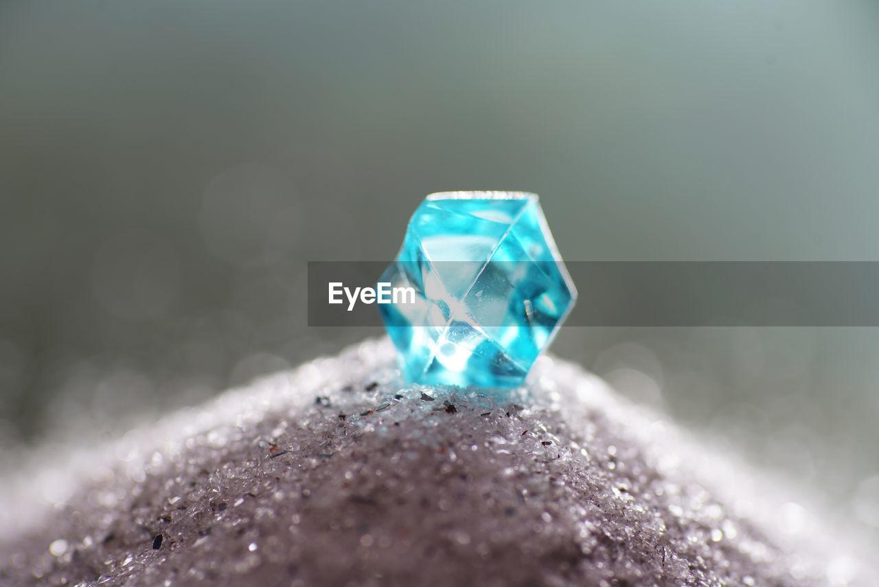Macro Shot Of Blue Crystal On Stone