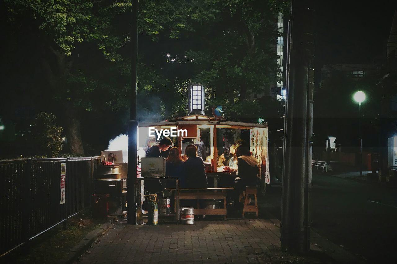 night, tree, real people, outdoors, men, illuminated, people