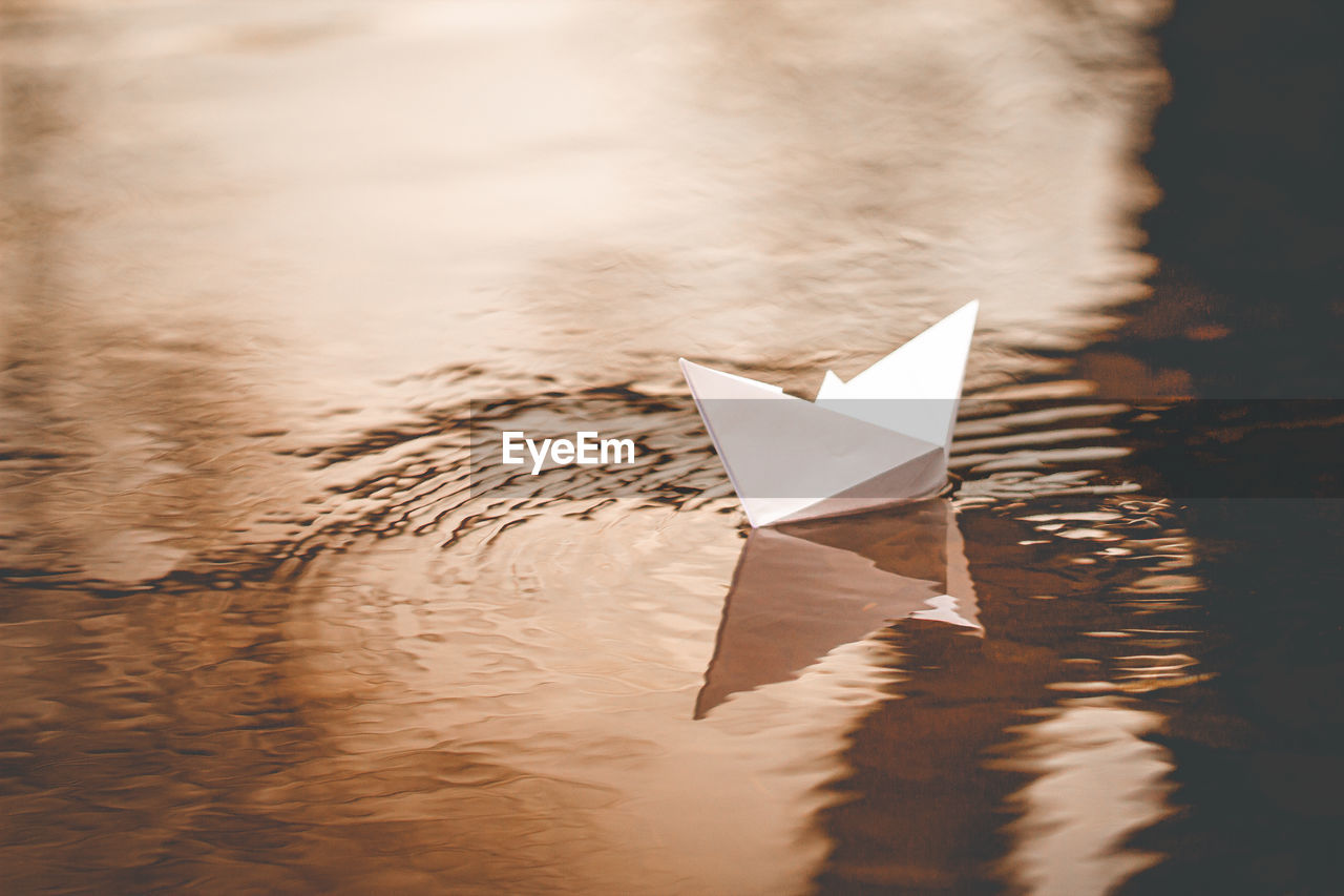 High angle view of paper boat floating on water