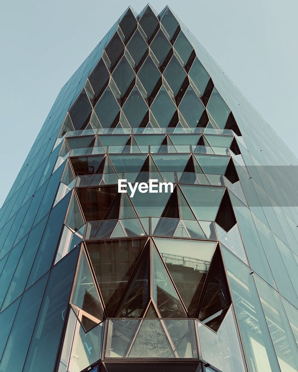 built structure, architecture, low angle view, sky, building exterior, clear sky, building, pattern, no people, modern, day, office building exterior, nature, city, office, glass - material, geometric shape, shape, reflection, design, skyscraper, architecture and art