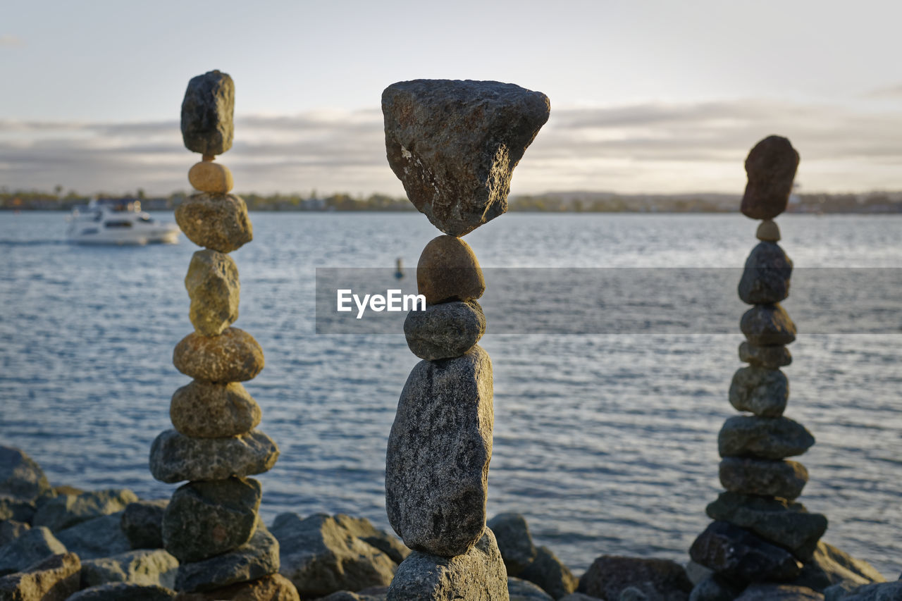 sea, sky, water, rock, tranquility, solid, no people, nature, tranquil scene, beauty in nature, rock - object, land, balance, stack, focus on foreground, scenics - nature, stone - object, beach, zen-like, horizon over water, outdoors, pebble