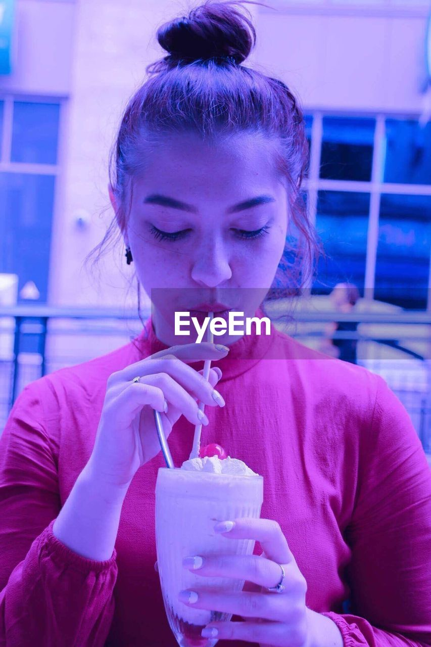 drink, drinking straw, drinking, refreshment, front view, food and drink, drinking glass, one person, milk, holding, real people, young adult, focus on foreground, milkshake, young women, indoors, portrait, freshness, day, close-up, people, adult, adults only