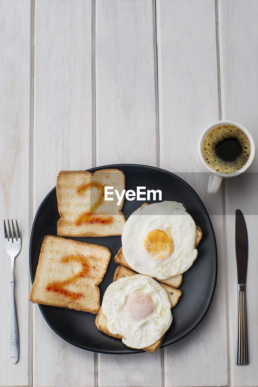food and drink, food, kitchen utensil, freshness, eating utensil, table, directly above, cup, ready-to-eat, still life, indoors, mug, coffee, drink, refreshment, egg, coffee - drink, coffee cup, healthy eating, plate, meal, breakfast, no people, table knife, fried egg, snack