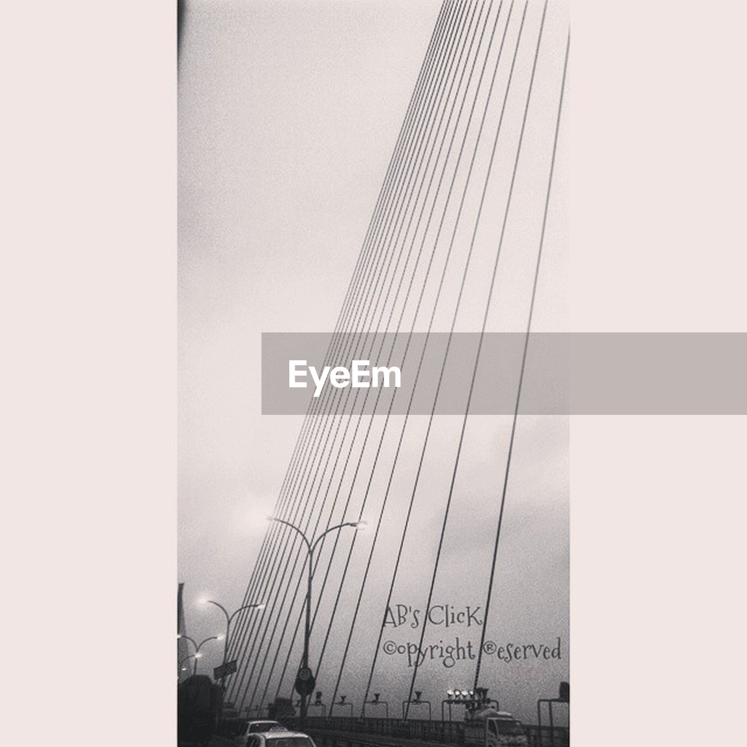 architecture, built structure, transportation, city, building exterior, skyscraper, tall - high, sky, mode of transport, modern, low angle view, travel, tower, connection, bridge - man made structure, engineering, day, office building, car, outdoors