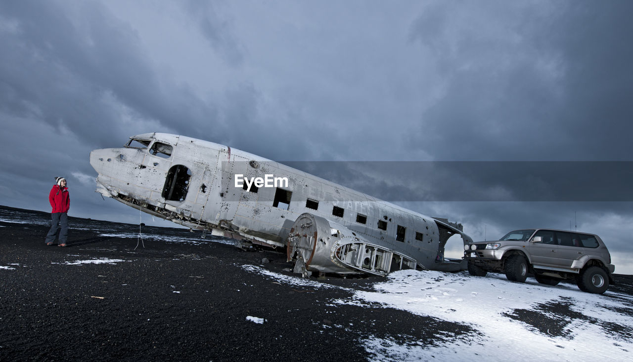 DAMAGED AIRPLANE ON SNOW COVERED LANDSCAPE