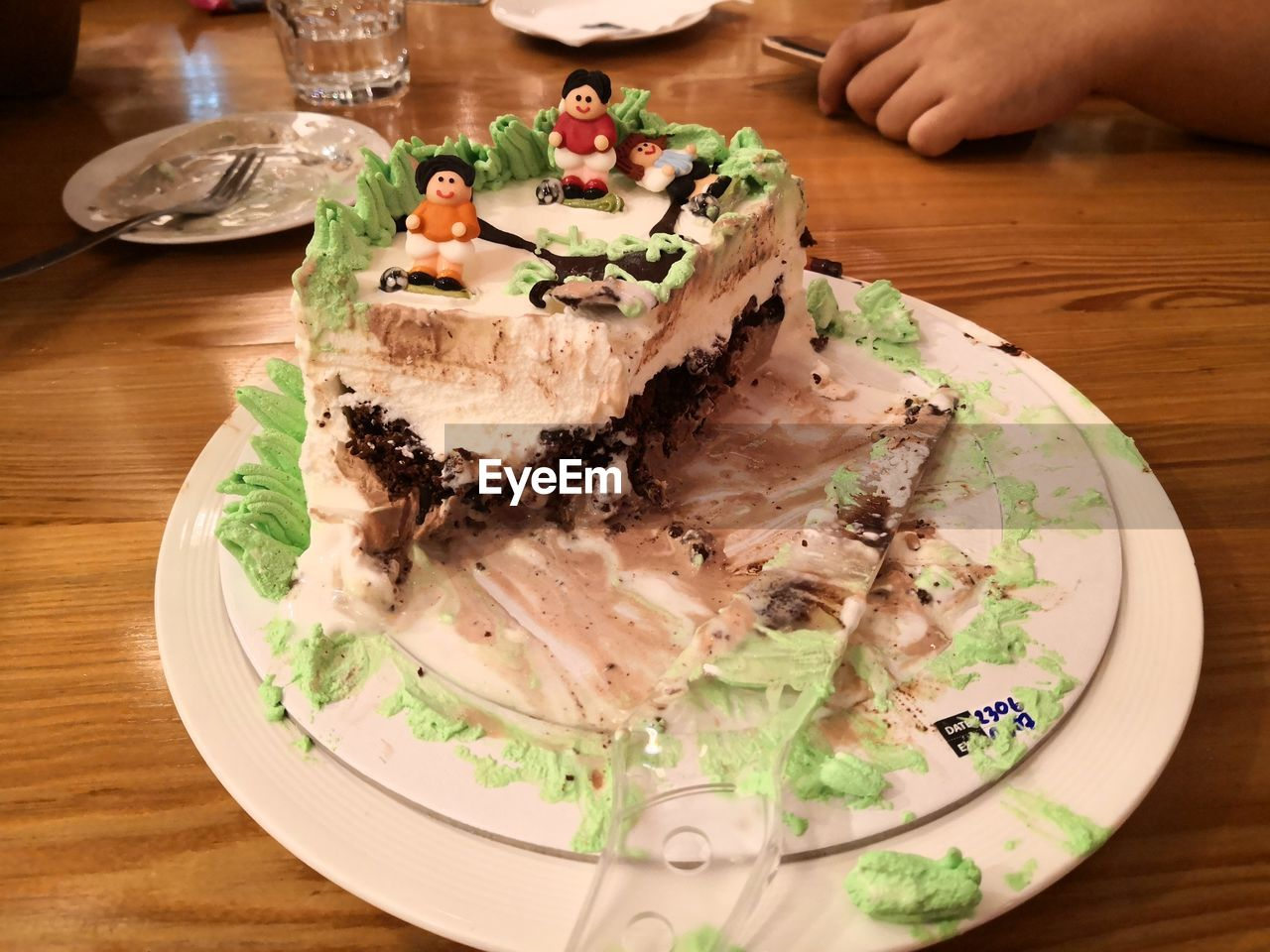 MIDSECTION OF CAKE ON TABLE
