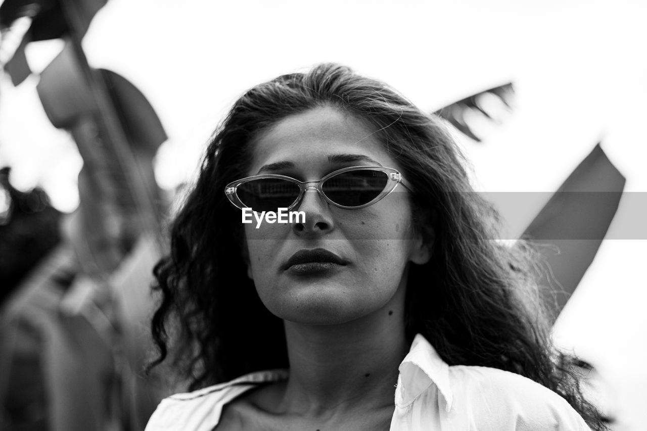 portrait, headshot, young adult, lifestyles, front view, sunglasses, young women, one person, real people, glasses, focus on foreground, leisure activity, fashion, day, women, looking at camera, casual clothing, hairstyle, beautiful woman, contemplation, human face