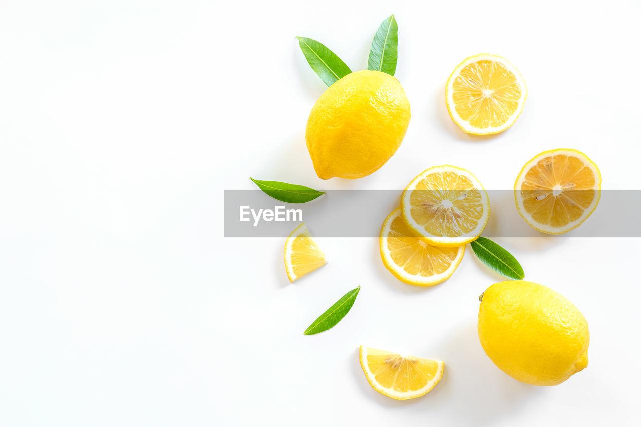 DIRECTLY ABOVE SHOT OF ORANGE FRUITS ON WHITE