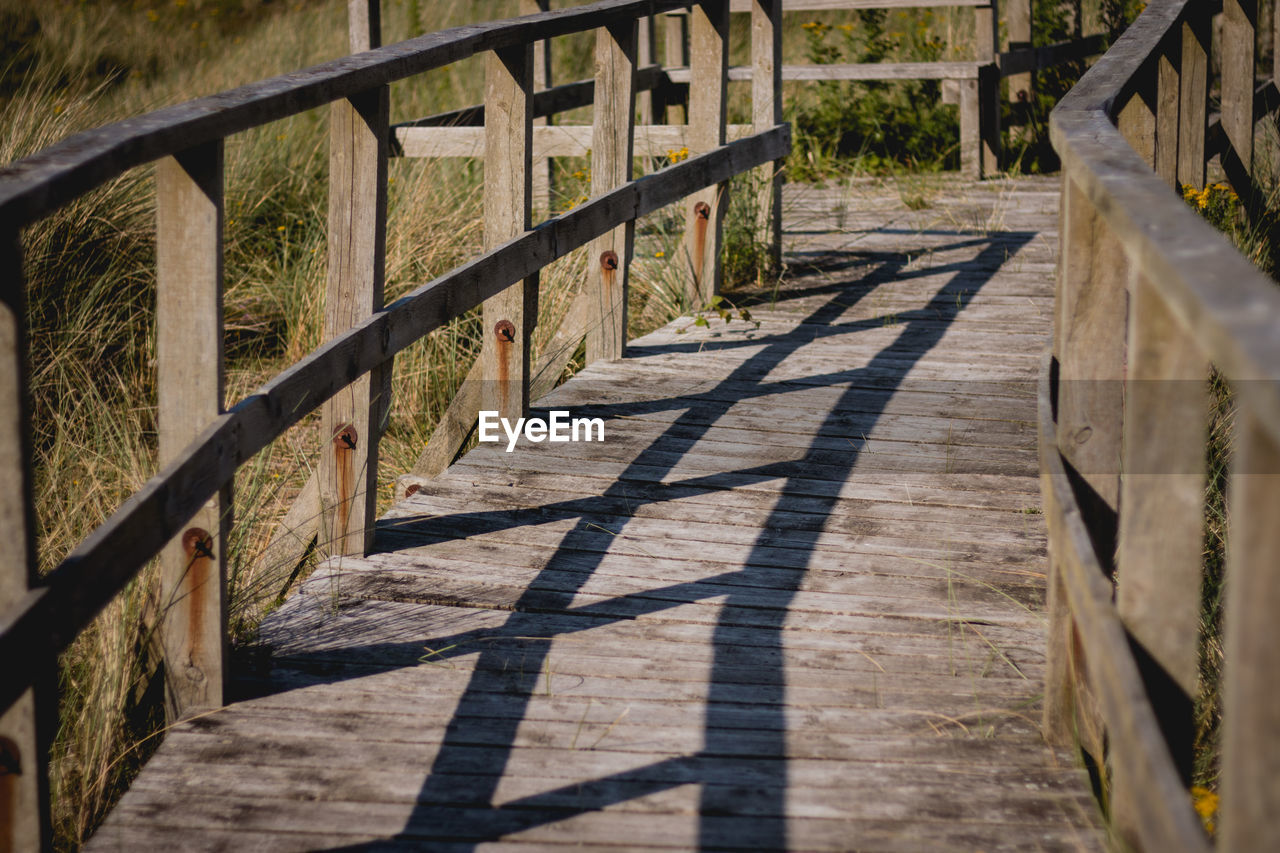 shadow, sunlight, railing, wood - material, no people, day, built structure, outdoors, nature, architecture