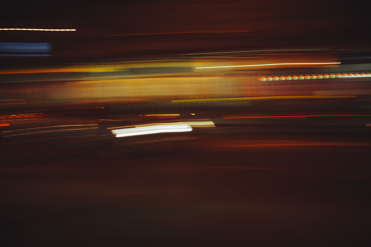 motion, speed, transportation, illuminated, blurred motion, long exposure, mode of transportation, light trail, night, no people, on the move, city, architecture, road, land vehicle, street, motor vehicle, car, city life, outdoors, vehicle light
