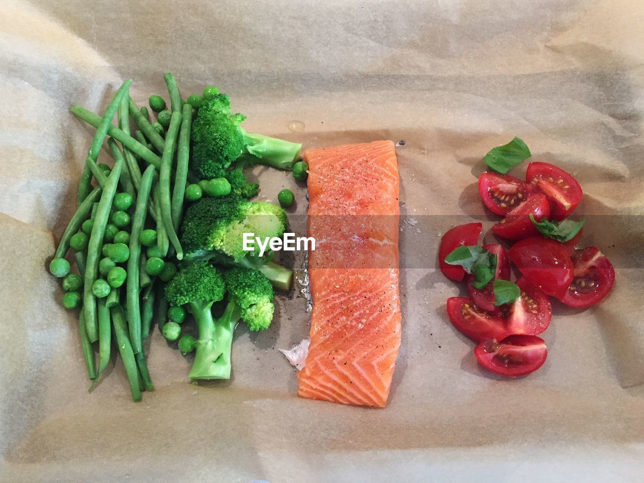 High angle view of vegetables and salmon on table