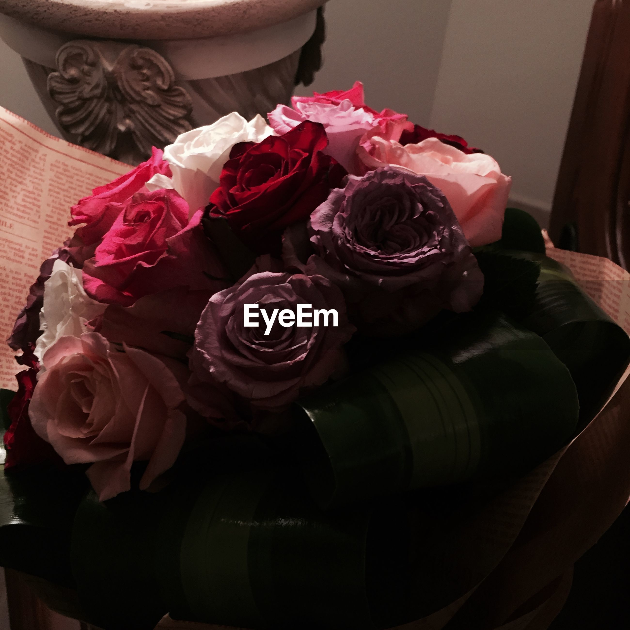 indoors, flower, close-up, still life, petal, pink color, home interior, rose - flower, high angle view, no people, table, freshness, variation, vase, flower head, decoration, bouquet, day, fragility, red