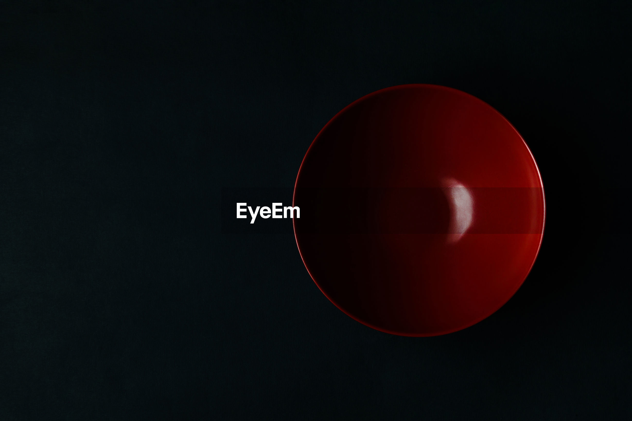 Close-up of red black bowl against black background