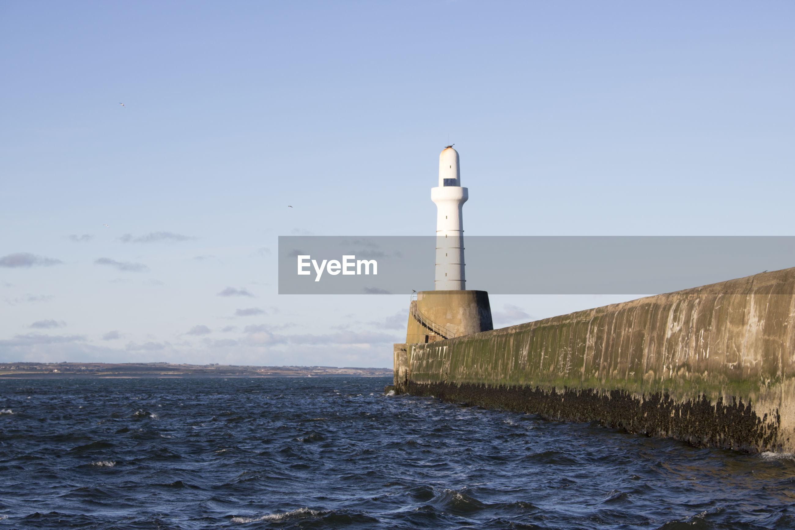 LIGHTHOUSE AGAINST SEA AGAINST CLEAR SKY