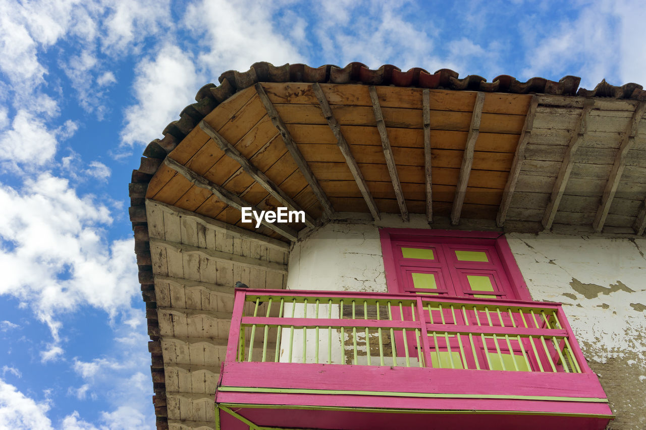 Low Angle View Of Wooden House Against Sky
